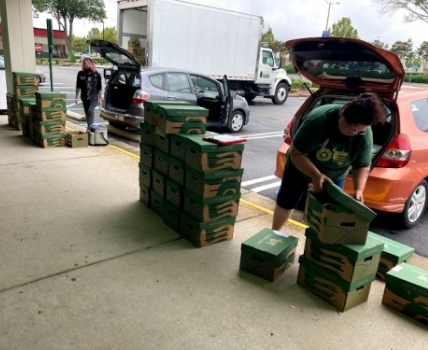 Market Managers preparing to deliver local seasonal produce and artisan goods